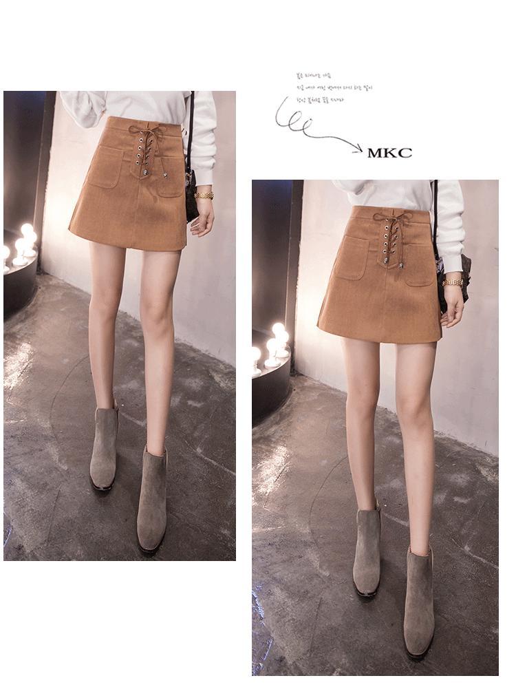 Chân váy 2 túi phối nơ dây da bò muahangbang1click