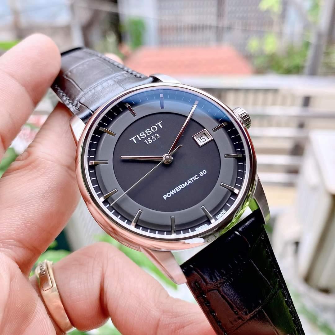 Đồng hồ Nam Tissot 1853 Luxury Automatic T086.407.16.051.00 Mặt đenLịch ngàyKính Sapphire-Máy cơ tự động-Dây da đen cao cấp-Size 41mm