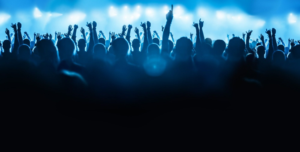 Background image of the crowd at a concert