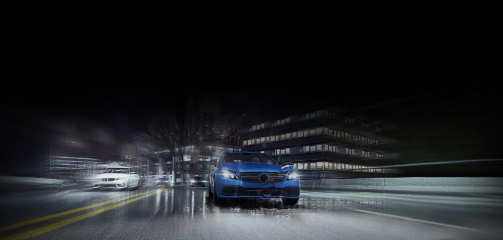 Photo of car racing down rainy street